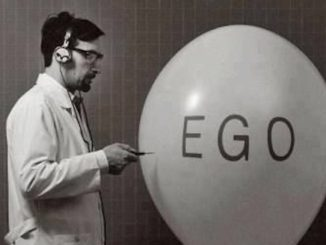 "Man popping balloon with ""ego"" written on it"