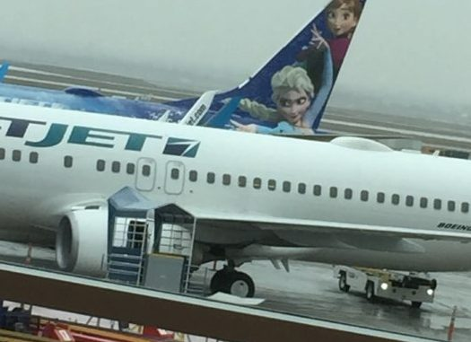 WestJet plane with Frozen skin