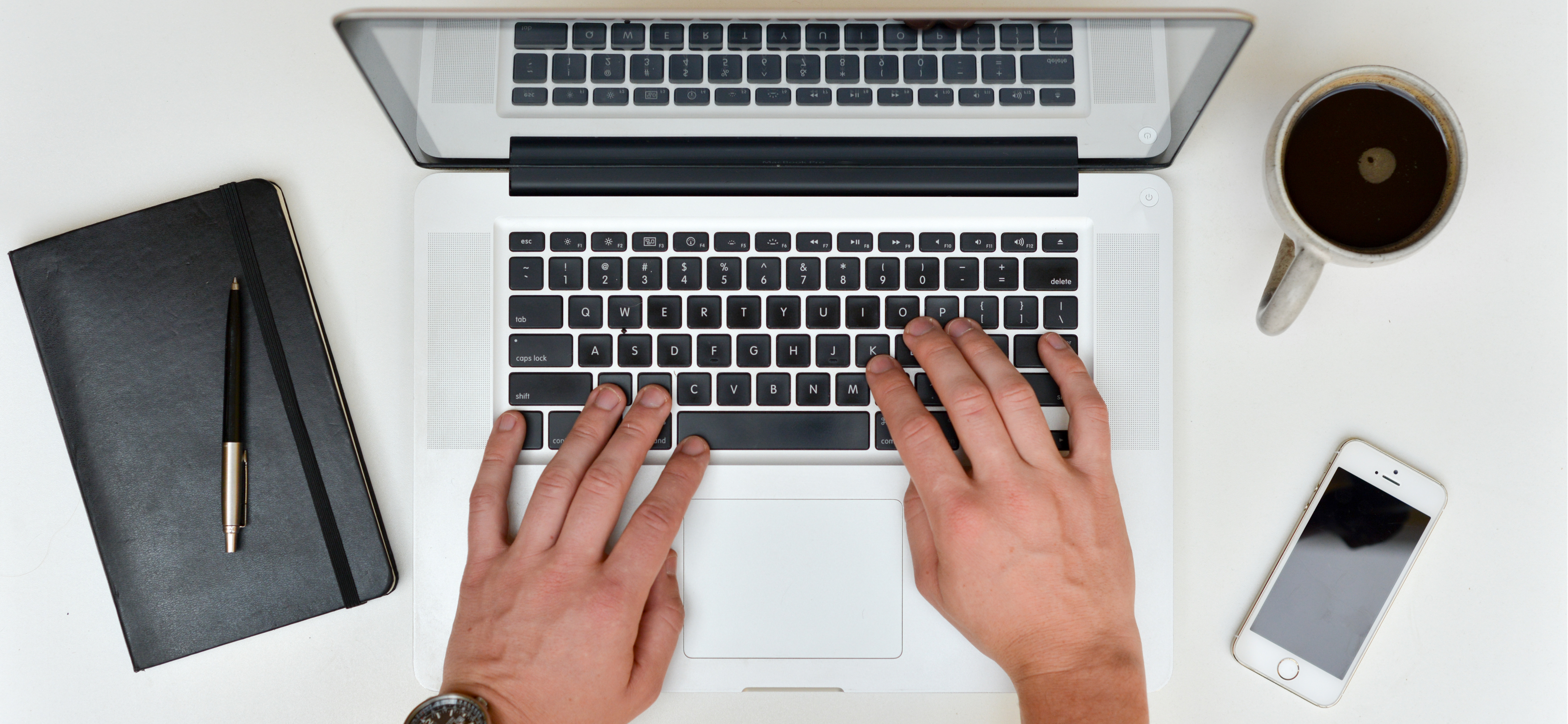 Hands typing on Mac