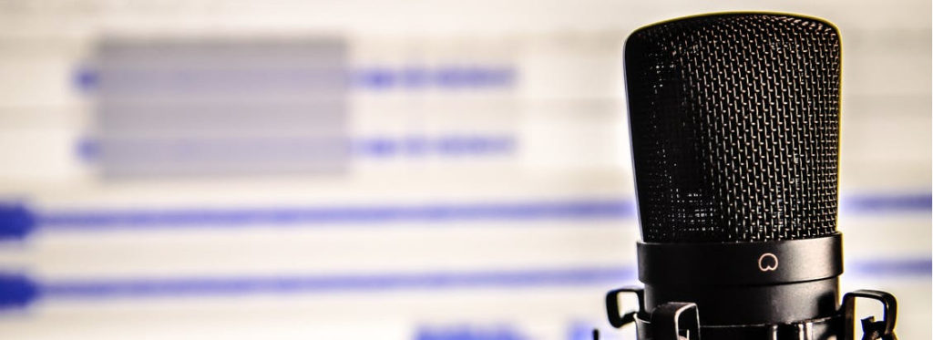 Microphone closeup with audio recording in background