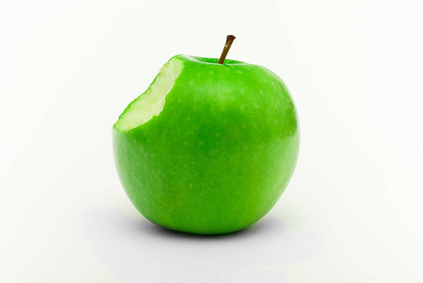 Green apple with a bite
