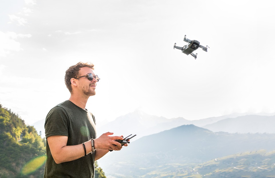 Man flying a small drone